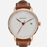 An image of Brathwait's rose gold automatic minimalist watch featuring a brown top-grain Italian leather strap.
