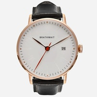 An image of the minimalist automatic watch featuring a black top-grain Italian leather strap sold by Brathwait.